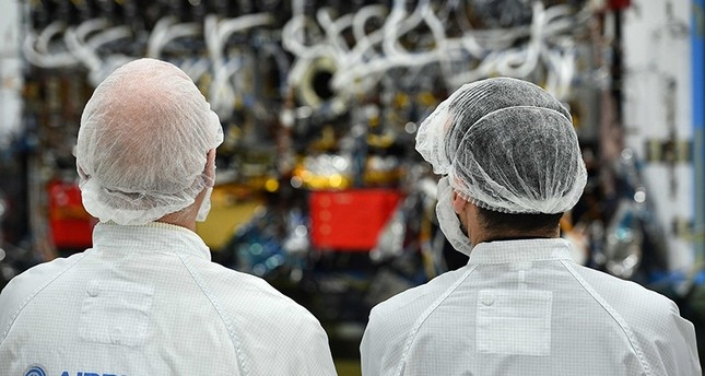 Media look at part of the Eutelsat Quantum satellite, billed as the first commercial satellite to be fully configurable in orbit, at Airbus Space and Defence in Portsmouth, southern England (AFP Photo)