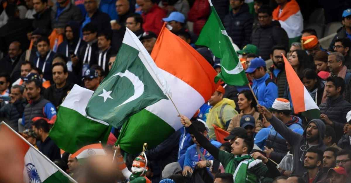 Spectators wave national flags after the 2019 Cricket World Cup group stage match between India and Pakistan at Old Trafford in Manchester, northwest England, on June 16, 2019. (AFP Photo)