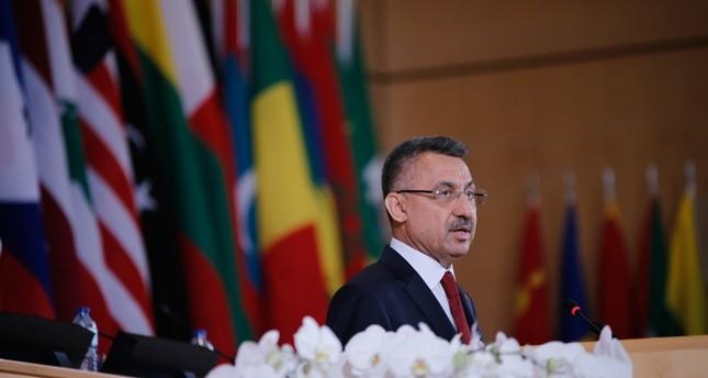 نائب الرئيس التركي فؤاد أوقطاي متحدثاً في الجلسة رفيعة المستوى لمنتدى العمل الدولي في جنيف (الأناضول)