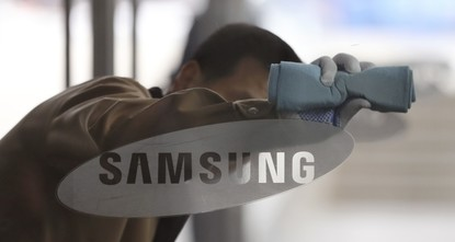 The world's biggest smartphone maker Samsung, assailed by a shambolic recall and embroiled in South Korea's wide-ranging corruption scandal, on Friday backed away from a planned corporate...