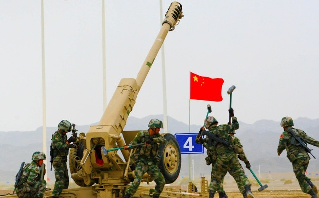 People's Liberation Army soldiers seen next to a howitzer during the International Army Games 2019 in Korla, Xinjiang Uighur Autonomous Region, China Aug. 5, 2019. Reuters photo