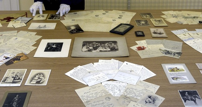 An employee at a museum in Tsarskoye Selo, the former summer residence of the tsars on the outskirts of Saint Petersburg, displays part of the collection of documents revealing the everyday life of the imperial Romanov family.