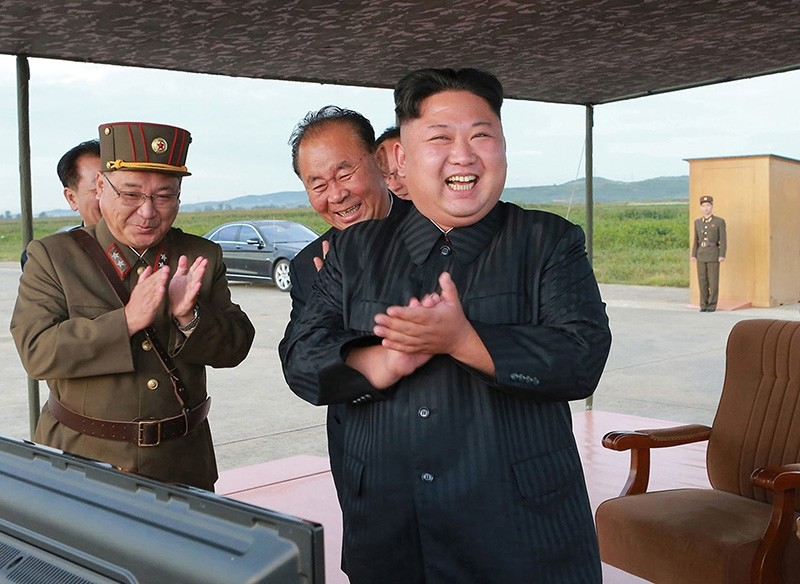 In this undated file photo distributed on Sept. 16, 2017, North Korean leader Kim Jong Un, right, celebrates what was said to be the test launch of an intermediate range missile. (AP Photo)
