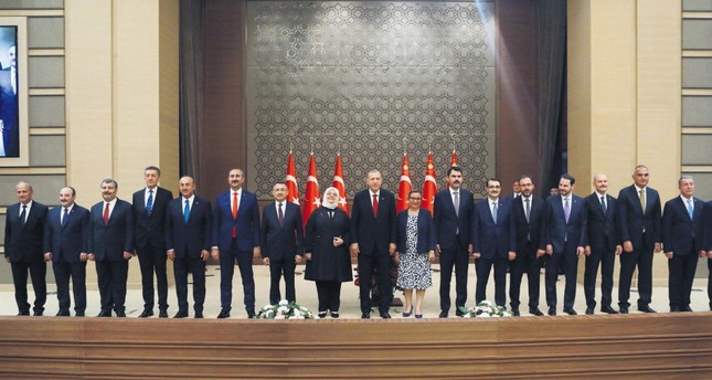 President Recep Tayyip Erdoğan (C), poses with the members of the newly appointed Cabinet following a news conference at the Beştepe Presidential Complex in Ankara, July 9.