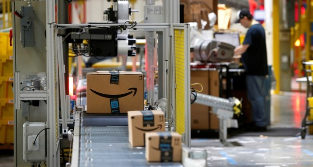 In this Aug. 3, 2017, file photo, packages pass through a scanner at an Amazon fulfillment center in Baltimore. (AP Photo)