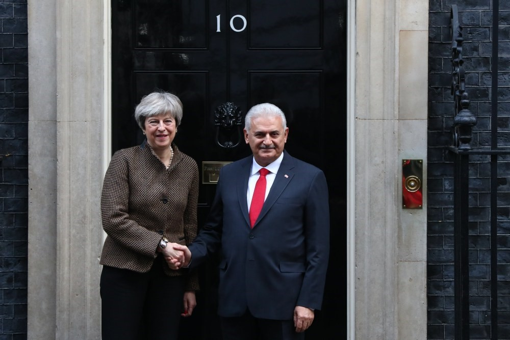 British Prime Minister May greets Prime Minister Yu0131ldu0131ru0131m for their bilateral meeting at number 10 Downing Street in central London, Nov. 27.