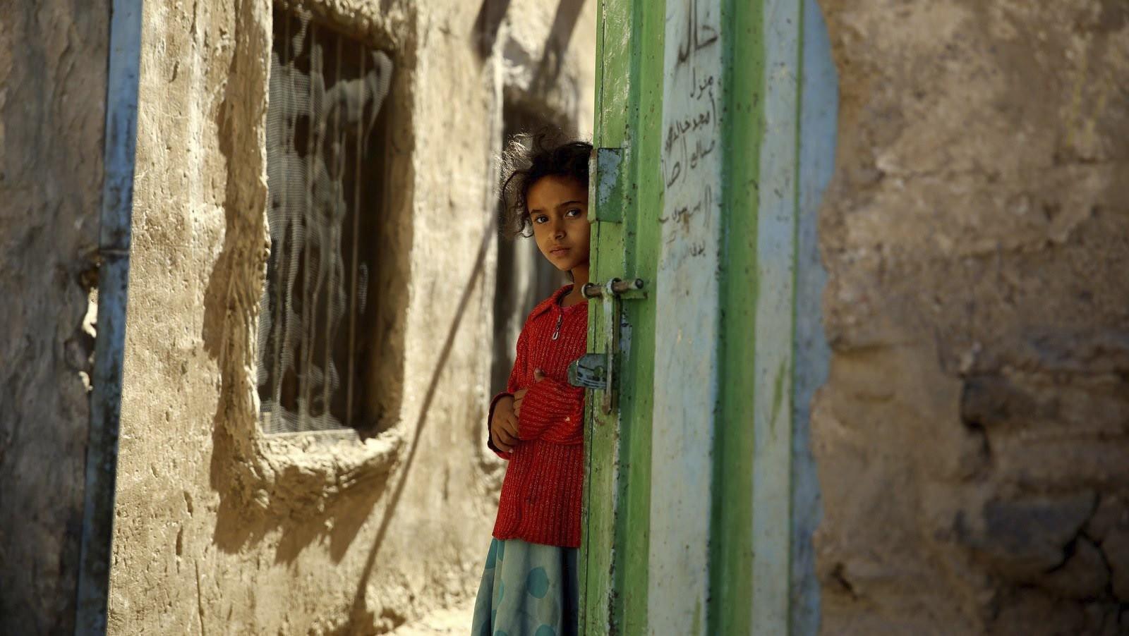 A Yemeni girl stands in a doorway in the conflict zone in Sanaa, Yemen, Nov. 9, 2015.