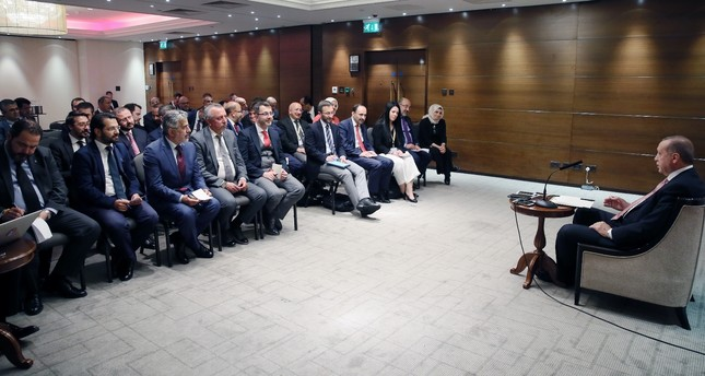 President Recep Tayyip Erdoğan speaks to members of the Turkish press in London late on Tuesday.