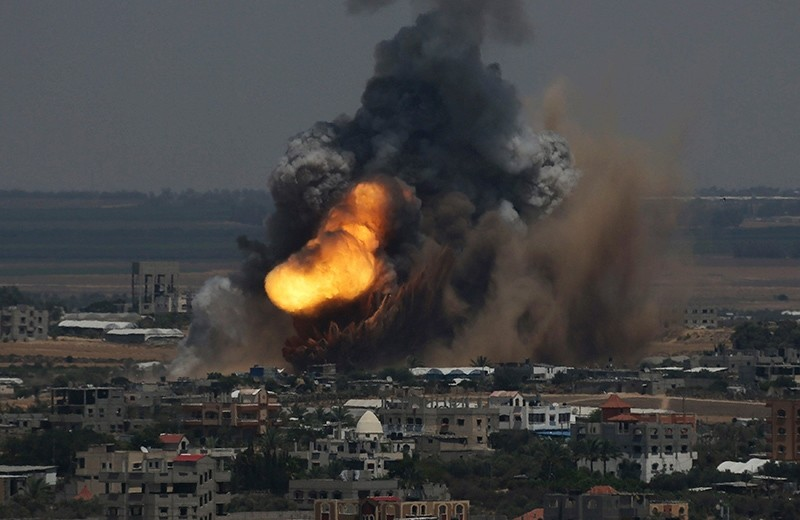 Smoke and flames are seen following an Israeli air strike in Rafah in the southern Gaza Strip, July 8, 2014. (Reuters Photo)