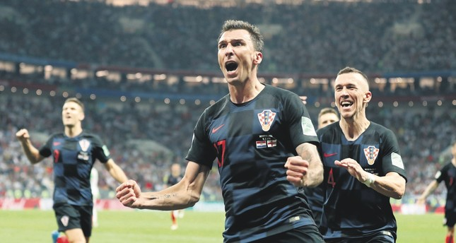 Croatia's Mario Mandzukic celebrates after scoring his side's second goal during the semifinal match against England on July 11.