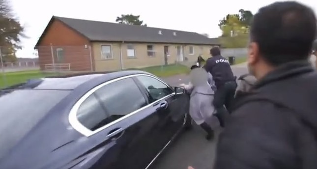 A screenshot from the video published by DR shows the refugee woman being hit by the minister's car.