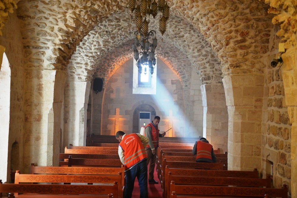Municipality workers clean a church in the town of Artuklu.