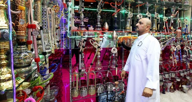 A man inspects water pipes at a shop in Kuwait City. The United Arab Emirates yesterday doubled the price of tobacco and increased soft drink prices by 50 percent, ahead of a more general tax on goods and services on Jan. 1 next year.