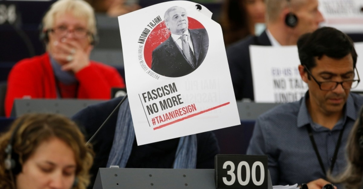 A portrait of European Parliament President Antonio Tajani with the slogan ,no more facism, is placed on the desk of a Member of the European Parliament during a voting session in Strasbourg, France, March 14, 2019. (Reuters Photo)