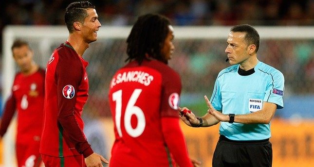 Cristiano Ronaldo (L) of Portugal argues with Turkish referee Cuneyt Cakir (R) during the UEFA EURO 2016 group F preliminary round match between Portugal and Iceland at Stade Geoffroy Guichard in Saint-Etienne, France, 14 June 2016.emEPA Photo/em