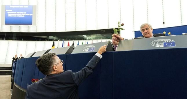 Catalan Deputy Ramon Tremosa of Convergencia i unio party hands a rose to European Parliament President Antonio Tajani in Strasbourg, Oct. 4.