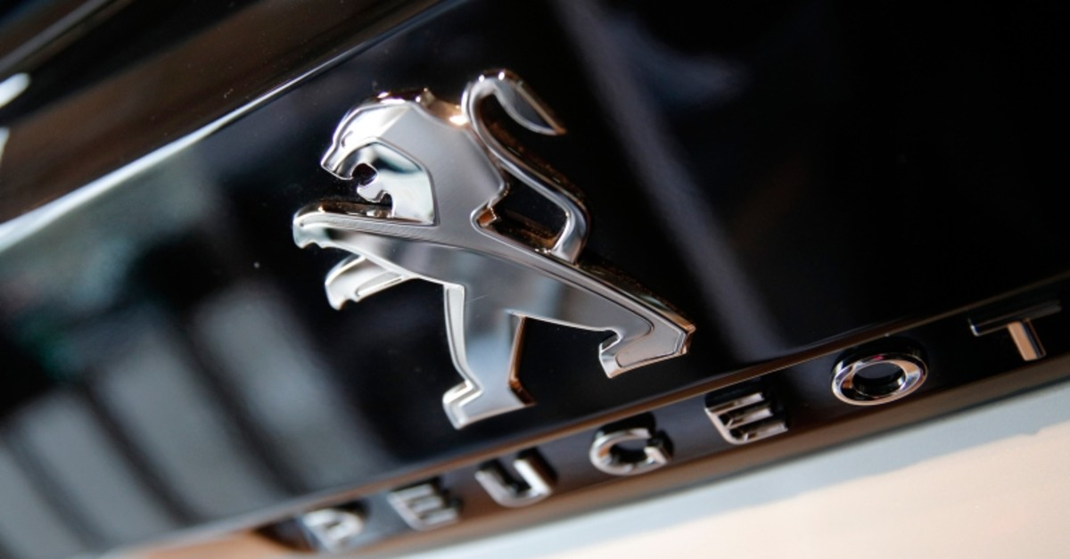 In this Feb.23, 2017 file photo, the logo of French automaker Peugeot is pictured during the presentation of the company's 2016 full year results, in Paris. (AP Photo)