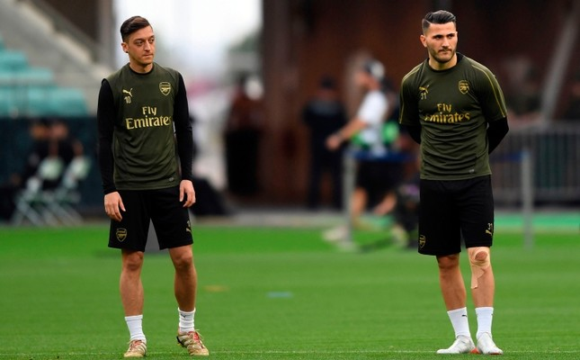 In this file photo taken on May 28, 2019 Arsenal midfielder Mesut Özil (L) and defender Sead Kolasinac attend a training session at the Baku Olympic Stadium on the eve of the UEFA Europa League final match between Chelsea and Arsenal. (AFP Photo)