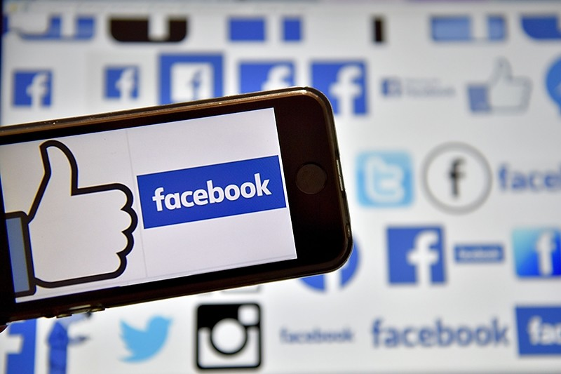 This file photo taken on December 28, 2016 shows logos of US online social media and social networking service Facebook in Vertou, western France. (AFP Photo)