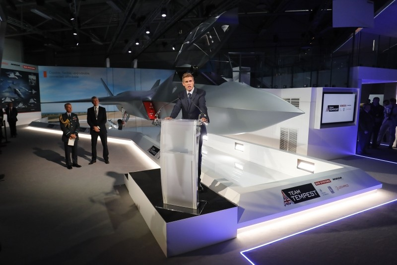 Britain's Defense Secretary Gavin Williamson speaks during the unveiling of a model of a new fighter jet, a part of Team Tempest, at the Farnborough Airshow, southwest of London, on July 16, 2018. (AFP Photo)