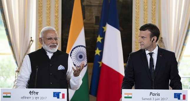 French President Emmanuel Macron, right, and Indian Prime Minister Narendra Modi, deliver a joint statement after their meeting at the Elysee Palace in Paris (AP Photo)