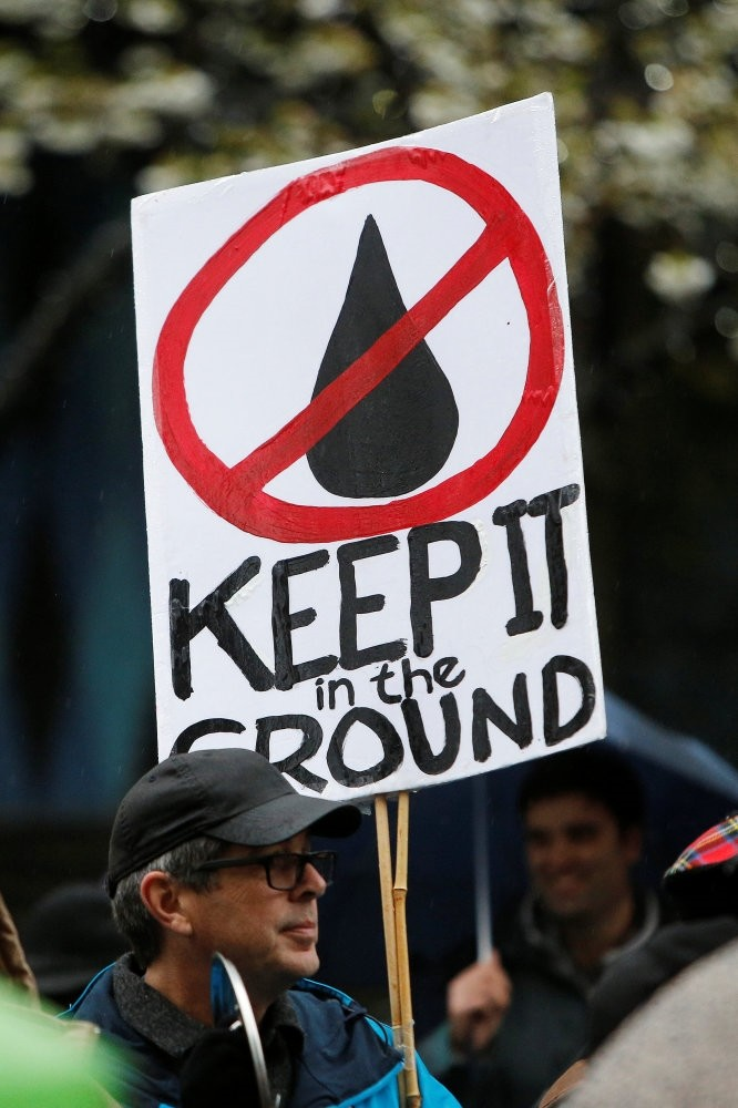 Opponents of the oil pipeline protest outside a Liberal Party fundraising event in Vancouver.