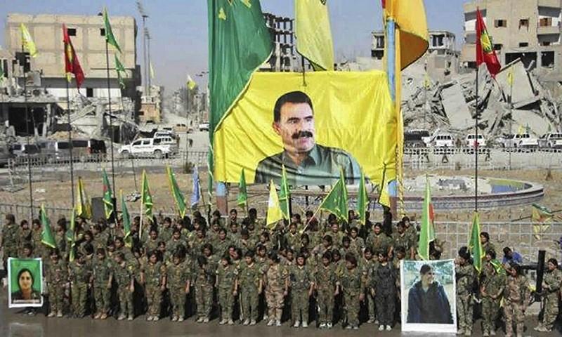 PKK female terrorists celebrating the victory against Daesh in Raqqa, Syria under the portrait of PKK leader Abdullah u00d6calan.