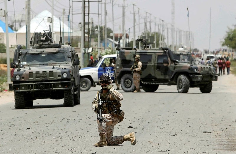 A soldier holds position as the damage is assessed after Islamist group al Shabaab hit a European Union armoured convoy in Mogadishu, Somalia October 1, 2018. (Reuters)