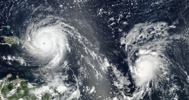 A Nasa satellite image shows Hurricane Irma (left) and Hurricane Jose (right) in the Atlantic Ocean. (Source: NASA)