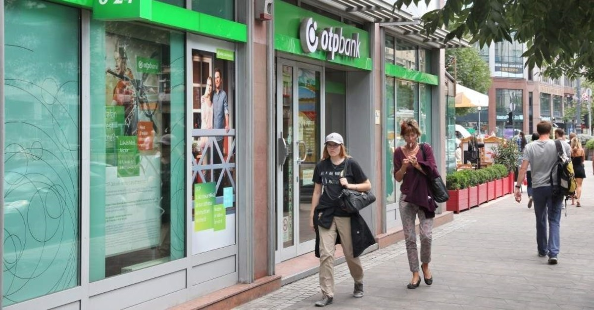 People walk by Hungary's biggest commercial bank, OTP Bank, in Budapest, Hungary, June 22, 2014. (iStock Photo)