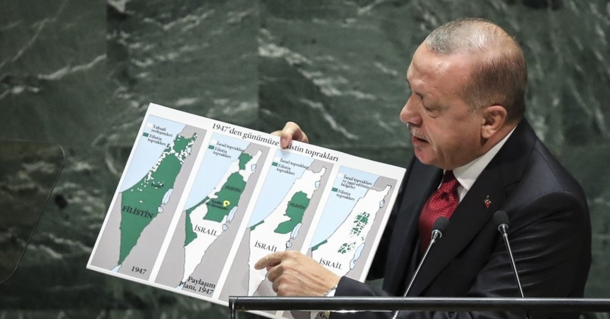 President Recep Tayyip Erdou011fan holds up a map showing the Israeli occupation of Palestinian territories since 1947 as he addresses to the United Nations General Assembly at U.N. headquarters, New York, Sept. 24, 2019.