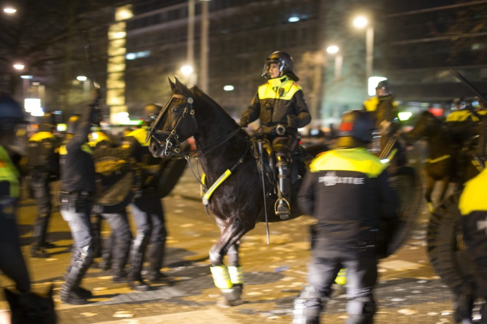 Dutch police attacking EU citizens of Turkish origin, who protest the Dutch goverment's scandalous treatment of the Turkish minister near Turkish Consulate in Rotterdam, March 12. (AP Photo)
