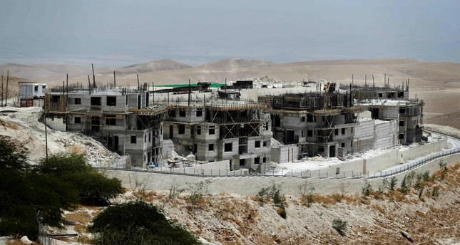 A picture taken on July 4, 2016, shows buildings under construction in the Israeli settlement of Maale Adumim, east of Jerusalem in the occupied West Bank. AFP Photo