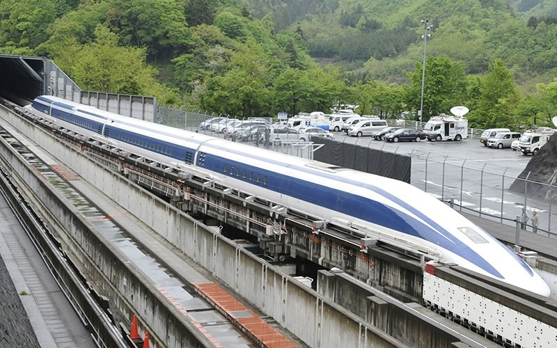 his file picture taken on May 11, 2010 shows the Maglev (magnetic levitation) train on the experimental track in Tsuru, 100km west of Tokyo. (AFP File Photo)