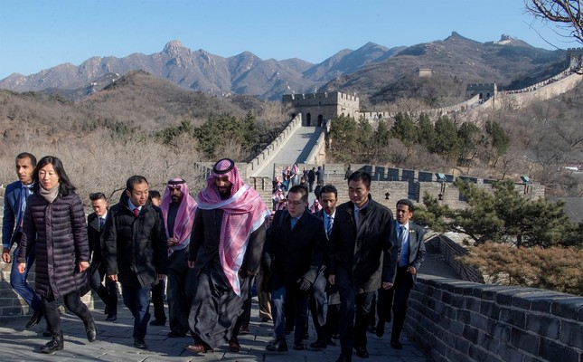 Saudi Arabia's Crown Prince Mohammed bin Salman walks with officials during his visit to Great Wall of China in Beijing, China, Feb. 21, 2019.