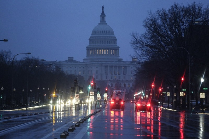 The Capitol is seen early Thursday, Jan. 24, 2019, as rain falls on Pennsylvania Avenue in Washington, with the partial government shutdown in its second month. (AP Photo)