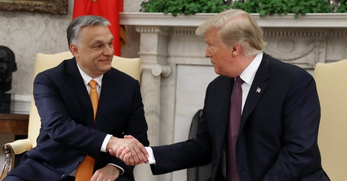 U.S. President Donald Trump shakes hands with Hungarian Prime Minister Viktor Orban during a meeting in the Oval Office on May 13, 2019 in Washington, DC.