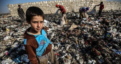Syrian children in war-torn Idlib scrape out living in garbage dumps