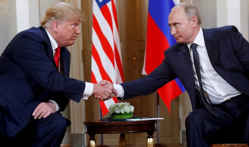 U.S. President Donald Trump, left, and Russian President Vladimir Putin shake hands at the beginning of a meeting at the Presidential Palace in Helsinki. (AP Photo)