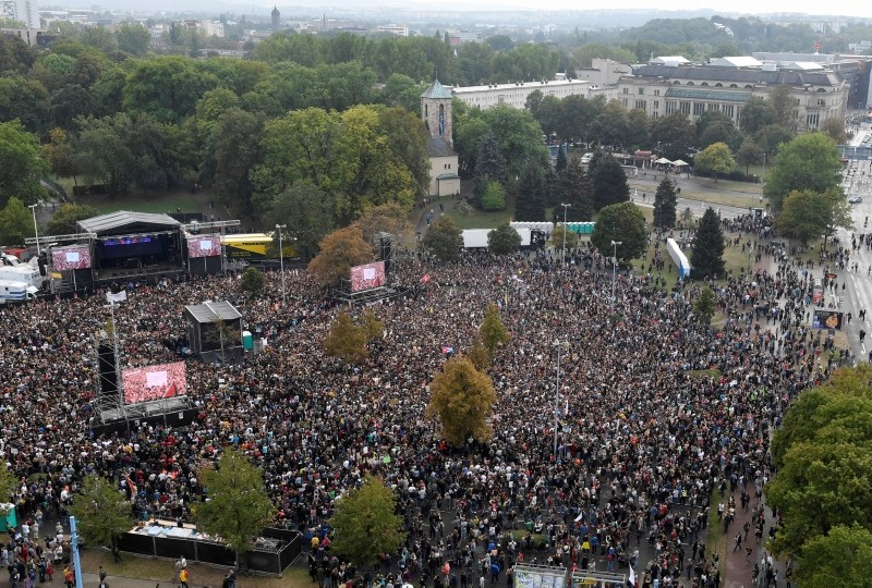 Concert goers stand in front of a stage in Chemnitz, Germany, September 3, 2018.