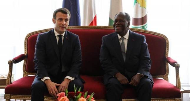 French President Emmanuel Macron meets with his Ivorian counterpart President Alassane Ouattara at the Presidential Palace in Abidjan on Dec. 21, 2019. AFP