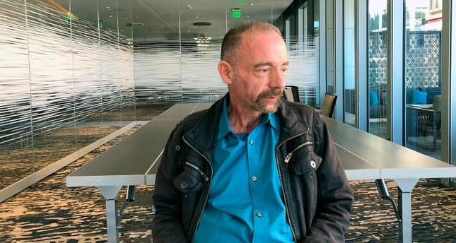 Timothy Ray Brown poses for a photograph, Monday, March 4, 2019, in Seattle. (AP Photo)