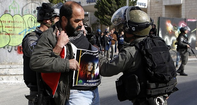 Israeli border police forcefully detain a Palestinian demonstrator in the West Bank city of Bethlehem. (EPA Photo)