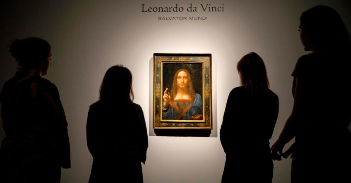 In this file photo taken on October 22, 2017 Christie's employees pose in front of a painting entitled ,Salvator Mundi, by Italian polymath Leonardo da Vinci at a photocall at Christie's auction house in central London. (AFP Photo)