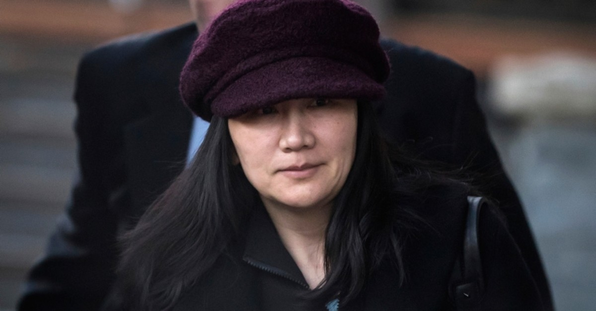 - In this Jan. 29, 2019, file photo, Huawei chief financial officer Meng Wanzhou leaves her home to attend a court appearance in Vancouver, British Columbia (AP Photo)