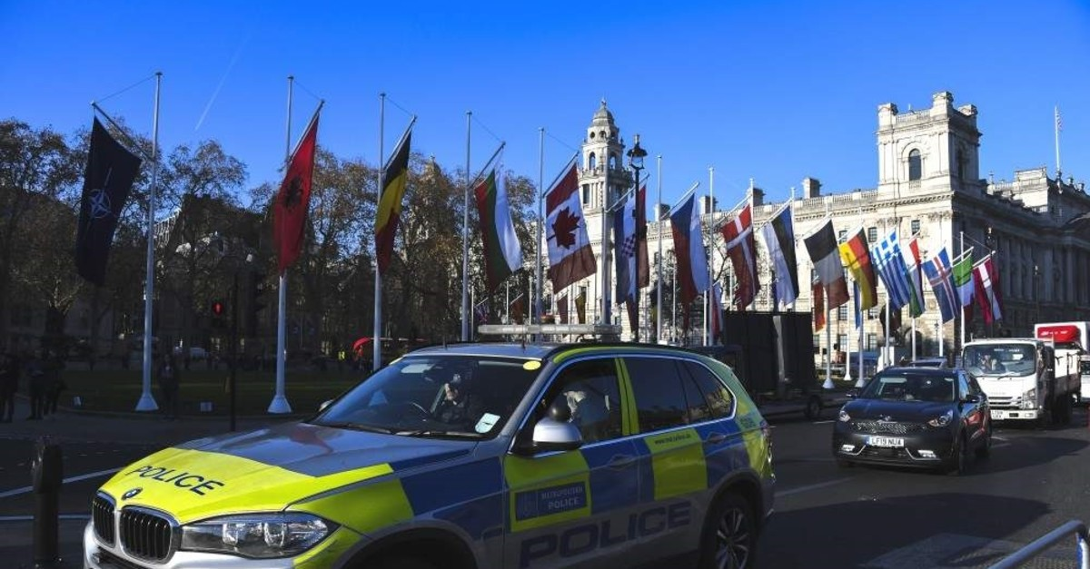 A police car drives past Parliament Square, ahead of the NATO summit in London, Dec. 2, 2019. (AP PHOTO)