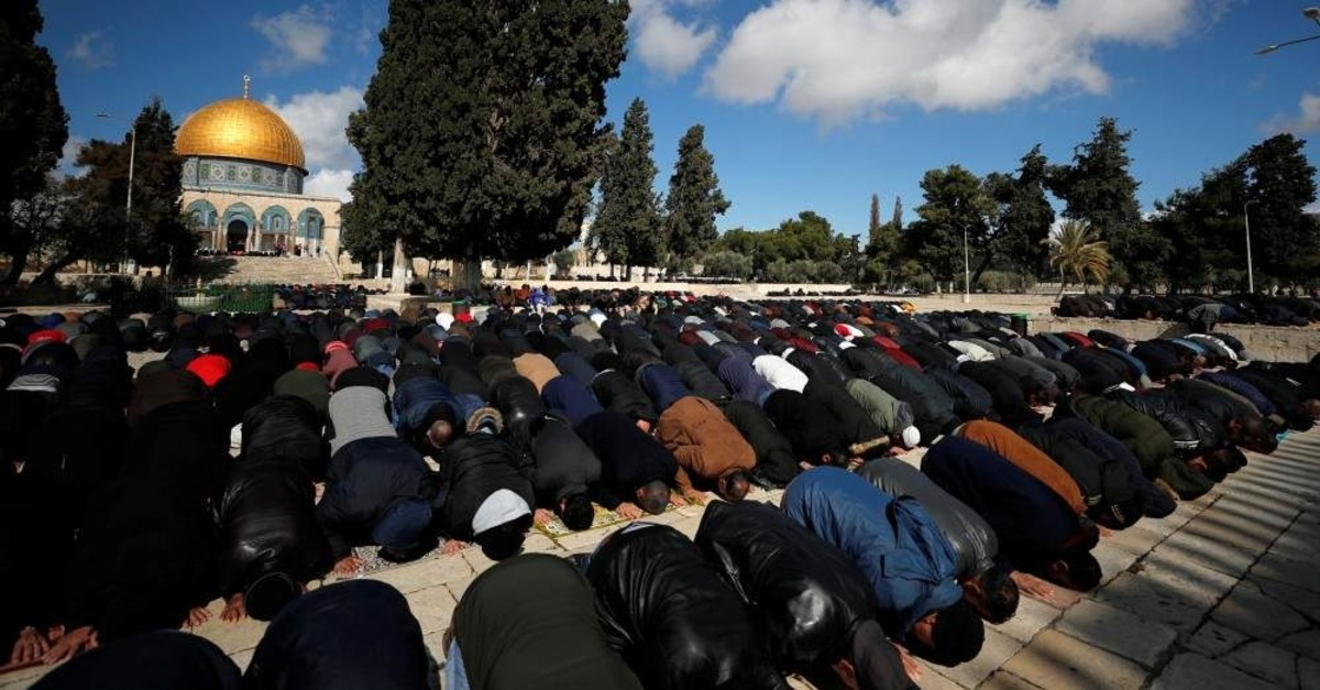 Palestinian men prays near the Dome of the Rock on the compound known to Muslims as the Noble Sanctuary and to Jews as Temple Mount in Jerusalem's Old City, Jan. 31, 2020. (REUTERS)