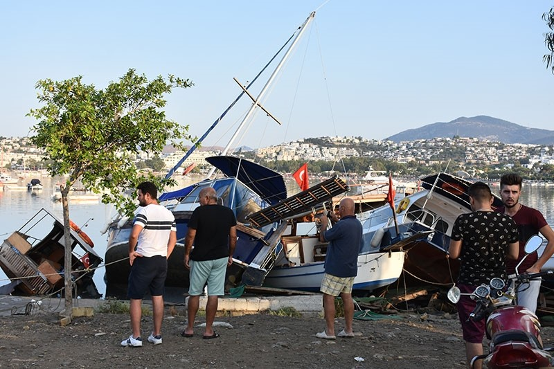 People look at damaged boats after the earthquake, in Bodrum, Turkey, July 21, 2017. (AA Photo)