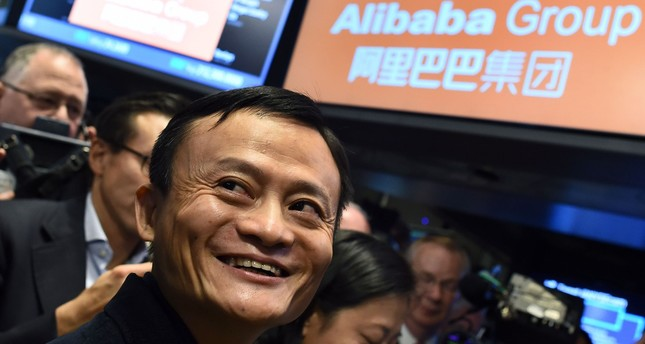 This file photo taken on September 19, 2014 shows Chinese online retail giant Alibaba founder Jack Ma smiling as he waits for the trading to open on the floor at the New York Stock Exchange in New York. (AFP Photo)
