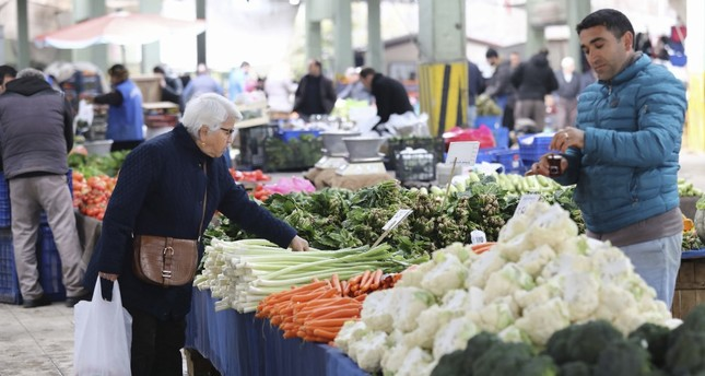 A woman shops for vegetables at a market in the capital Ankara, Feb. 13, 2019.